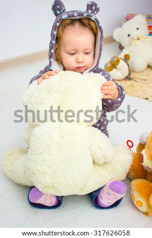 Portrait of little girl with teddy bear at home, home comfort and leisure - stock photo