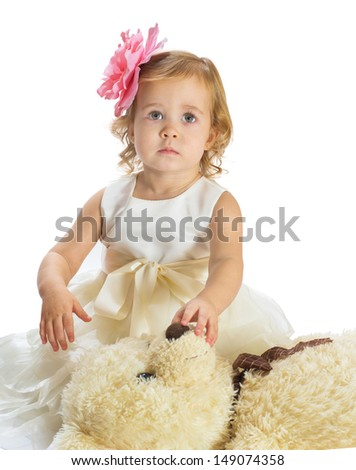 Portrait of little girl with teddy bear isolated on white background - stock photo