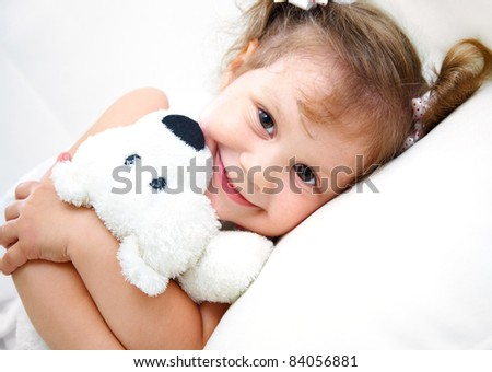 Portrait of little girl with teddy bear on white background - stock photo