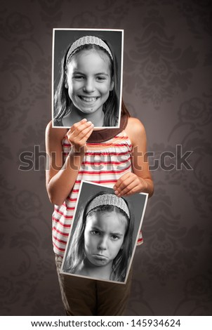 portrait of little girl with two faces - stock photo