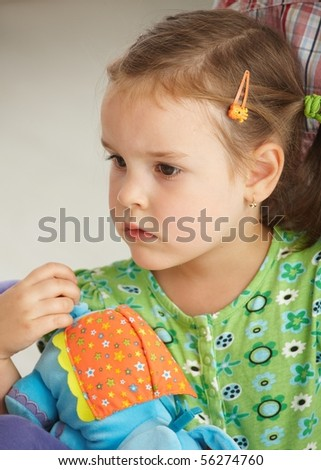Portrait of little girl (3-4 years) looking seriously. - stock photo