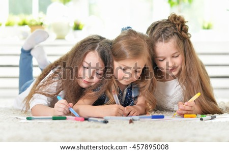 Portrait of Little girls drawing - stock photo
