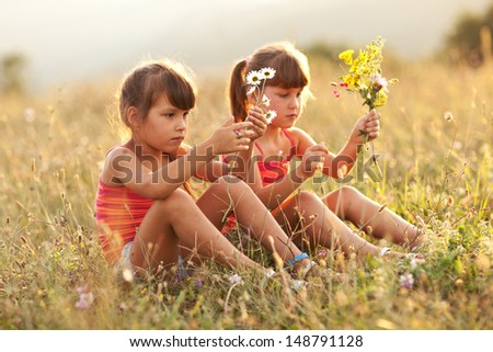 portrait of little girls outdoors in summer - stock photo