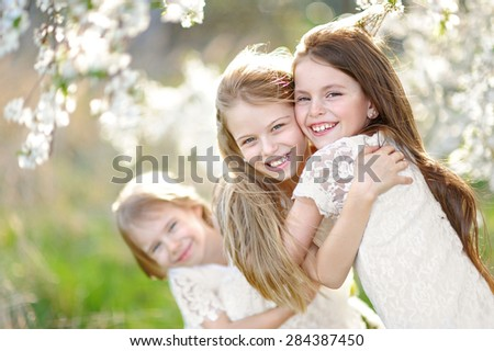 Portrait of little girls sisters in spring