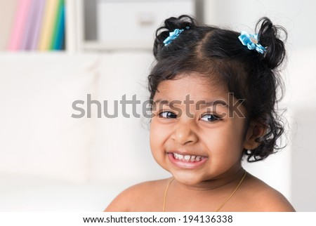 Portrait of little Indian baby girl smiling. Asian child living lifestyle at home. - stock photo