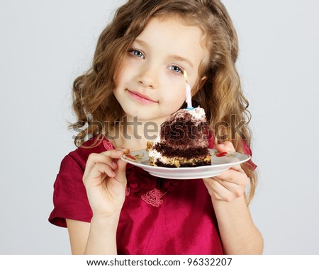 Portrait of little pretty girl with birthday cake - stock photo
