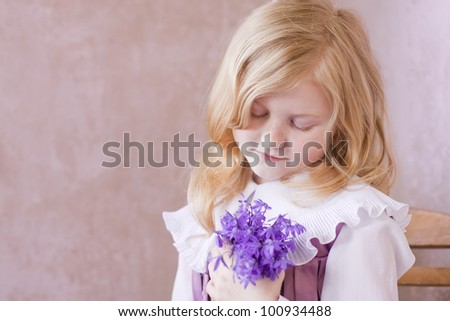 portrait of little pretty girl with flowers