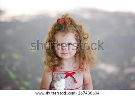 Portrait of Little pretty girl with ice cream  - stock photo