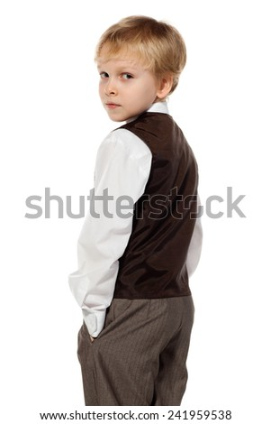 Portrait of little school boy in business suit is looking back, isolated on white background - stock photo