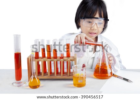 Portrait of little schoolgirl wearing lab coat and doing research, isolated on white background