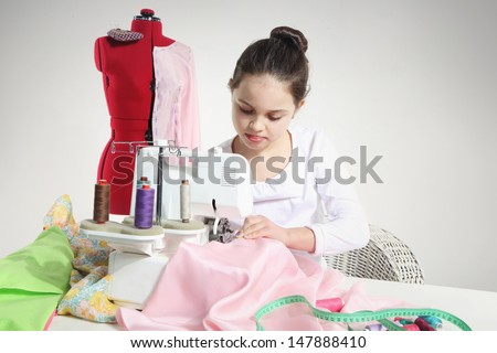 Portrait of little seamstress