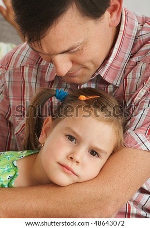 Portrait of little tired daughter resting with father, sitting. - stock photo