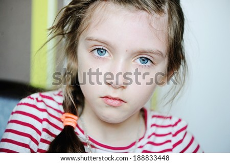 Portrait of little unhappy child girl - stock photo