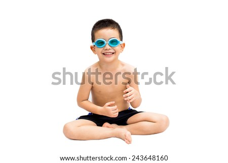 Portrait of little young boy in swimsuit and blue swim goggles isolated on white background