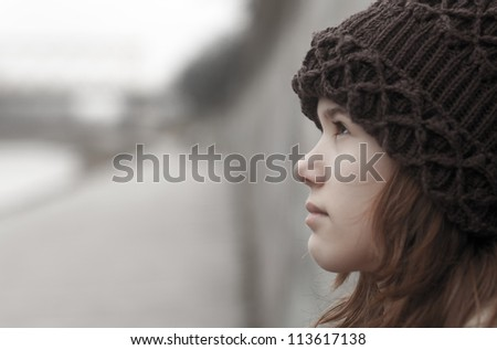 Portrait of lonely teenage girl on moody autumn day. - stock photo