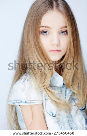 Portrait of long haired girl with blue eyes. Isolated on white - stock photo