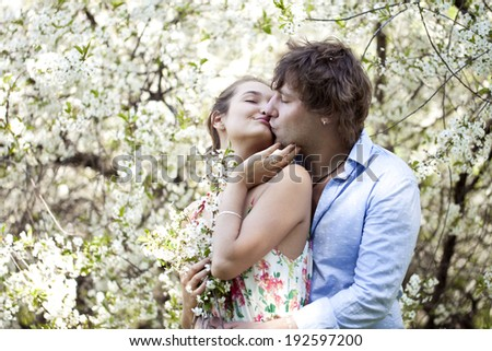 Portrait of love couple embracing outdoor