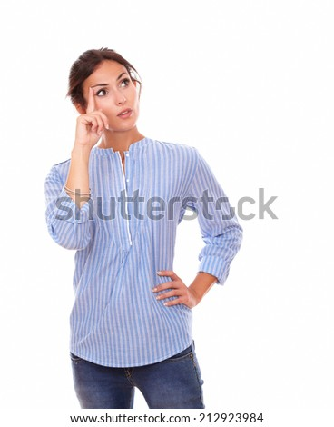 Portrait of lovely adult woman on blue blouse asking a question while looking up to her left and standing on isolated white background - copyspace - stock photo