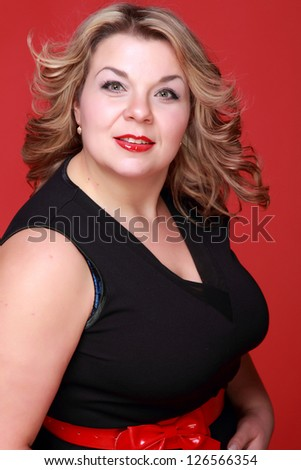 Portrait of lovely adult woman over bright red background
