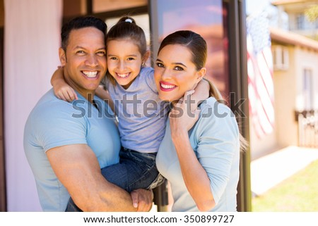 portrait of lovely american family in their home