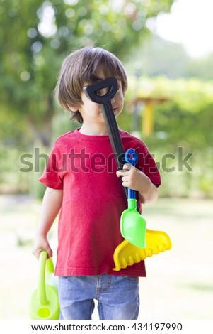 Portrait of Lovely Boy Enjoying Outdoors, Boy Playing - stock photo