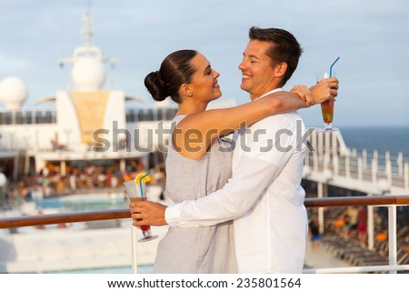 portrait of lovely couple embracing on cruise ship - stock photo