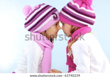 Portrait of lovely embracing kid girls wearing winter clothing - stock photo
