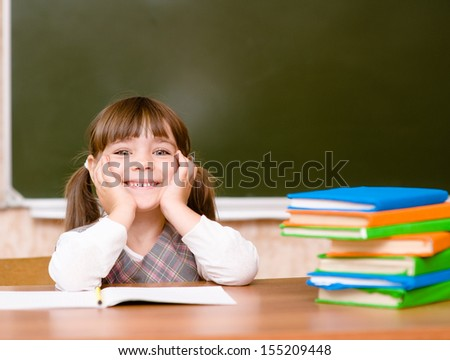 Portrait of lovely girl in classroom. - stock photo