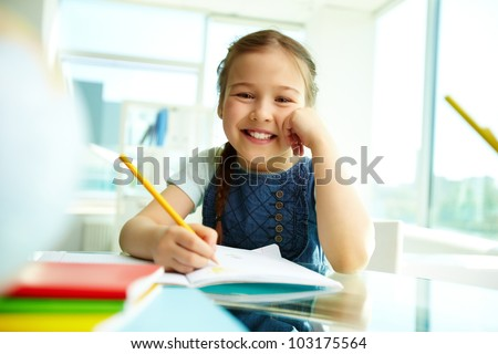 Portrait of lovely girl looking at camera with smile - stock photo