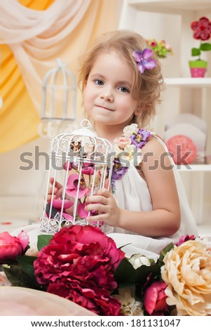 Portrait of lovely girl posing with flowers