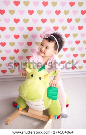 Portrait of lovely little girl  playing with toy - stock photo