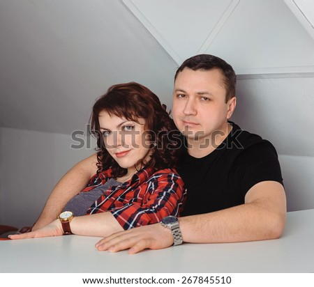 Portrait of lovely married couple at home - stock photo