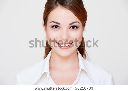 portrait of lovely smiley woman in white shirt - stock photo