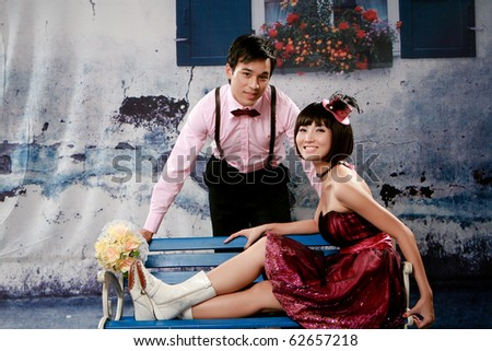 Portrait of lovely young couple looking to you - stock photo