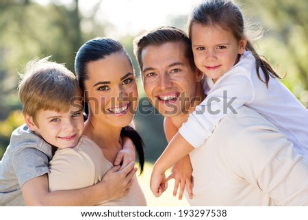 portrait of lovely young family together outdoors