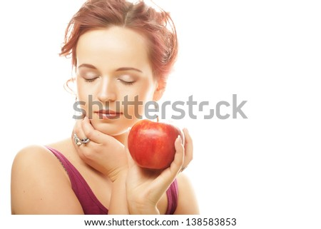 Portrait of lovely young girl with a red apple in hand over white background