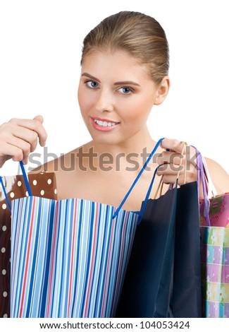 Portrait of lovely young woman with colorful shopping bags. Isolated on white background