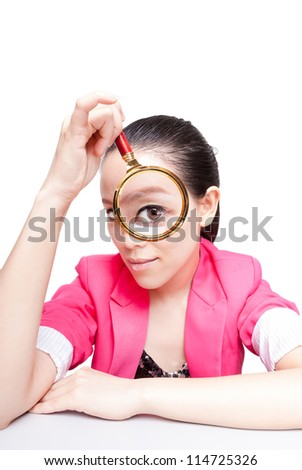 Portrait of lovely young woman with magnifying glass showing her white teeth