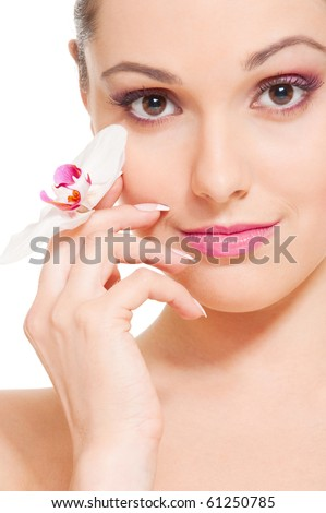 portrait of lovely young woman with orchid - stock photo