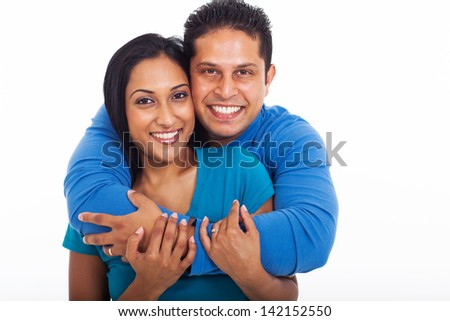 portrait of loving couple embracing isolated on white background - stock photo
