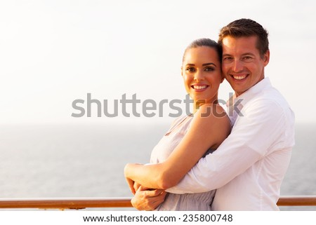 portrait of loving couple embracing on cruise ship