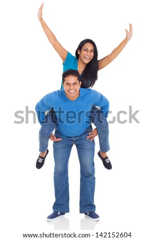 portrait of loving indian couple having fun with piggyback ride isolated over white background - stock photo