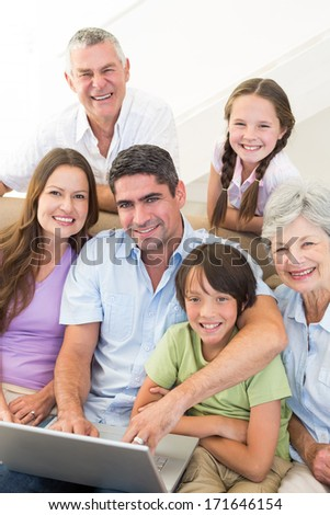 Portrait of loving multi-generation family spending leisure time at home - stock photo