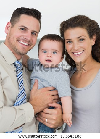 Portrait of loving parents with baby boy at home