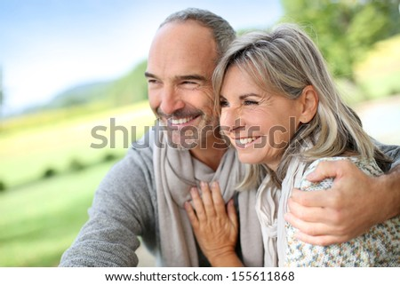 Portrait of loving senior couple - stock photo