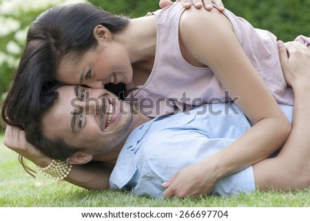 Portrait of loving young couple enjoying together in park - stock photo