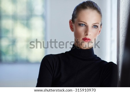 Portrait of luxury brunette woman in black sweater. - stock photo