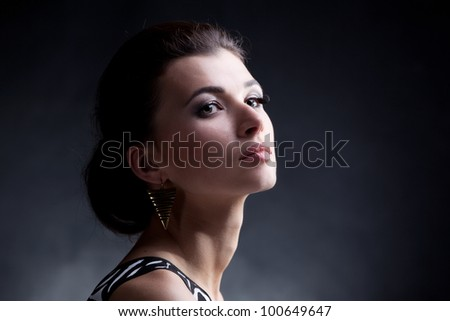 Portrait of luxury woman in exclusive jewelry on black background