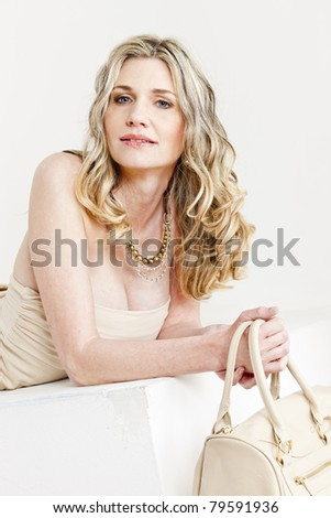 portrait of lying woman wearing summer clothes with a handbag