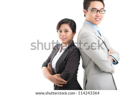 Portrait of male and female colleagues standing back to back - stock photo